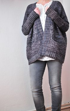 Solace is a textured, oversized cardi featuring flattering slim sleeves and optional pockets. The design is intended to be worn with a large amount of positive ease in the body and zero ease in the sleeves. It is suggested that you measure your upper arm circumference and select a size that corresponds to this measurement. Sample is shown in size S.