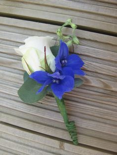 white rose and blue delphinium boutonniere | Google Image Result for http://www.johicksflowers.co.uk/blog/wp ...