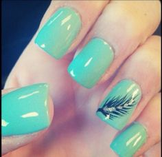 Mint Colored nails with a feather, just love!