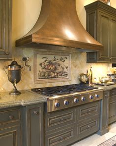 The Cynara Mural is a classic design; this backsplash creates a warm and inviting feel in your kitchen