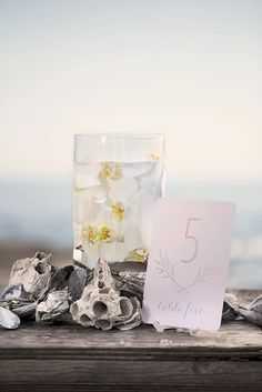 Mint Stationery featured in latest Wedding Album magazine's cover story. Pictured here: Close-up of table numbers. Photography: HSMimages.co.za #beachwedding #decor #fashion #weddingalbum #mintstationery #blush #watercolor #wedding #ideas #table #numbers