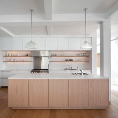 Space4Architecture has used only three main materials to decorate a duplex apartment in Tribeca, which was designed around the need for ample storage.