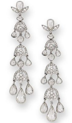 A pair of diamond pendent earrings  Composed of an articulated series of slightly graduating anthemion motifs, pavé-set with brilliant-cut diamonds, each suspending three rose-cut diamond drops, length 6.1cm.