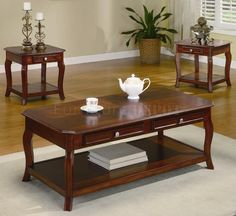Traditional coffee table appears to be longer than it is wide, by double or more and is the appropriate height off the ground. It has an additional storage shelf.