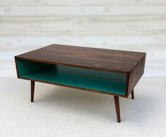 The Slim: Handmade Coffee Table Mid Century Modern Cherry Cola and Teal Coffee Table by TinyLionsDesigns on Etsy https://www.etsy.com/listing/229050590/the-slim-handmade-coffee-table-mid