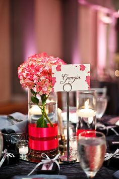 Love the pink in the flowers… makes this table setting look romantic.. photographer: Nadia D. Photography