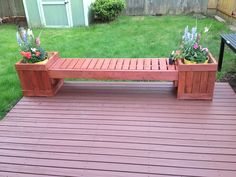 Built this bench out of pallets for my brother.  He stained it to match his deck.
