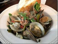 Sausage and Clams - capturing the flavors of a sausage and peppers sandwich and the briny flavor of clams. Just scrumptious! http://www.lindasitaliantable.com/recipe-of-the-month-august-sausage-and-clams/