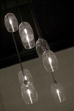 Ribbed glass pendants by tL* Custom Lighting  http://www.tlcustomlighting.com/fixtures-and-shades/pendants/