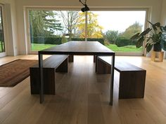 Solid walnut dining table with stainless steel legs & solid walnut benches