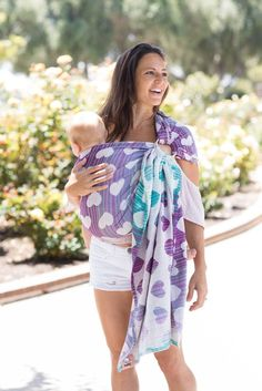Hearts ring sling. Tula Love Selene - Cotton Ring Sling. Set against a gradient sky of blues and purples, 'Love' Selene has a scattered heart design that is whimsical and bold. In very little time, these all cotton ring sling will become soft and easily adjustable with a fluid drape and soft support. 'Love' Selene will mold perfectly around newborns up to growing toddlers while you are on the go.