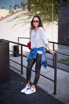Blogger Style l Aimee Song (Song of Style): light blue striped button-down shirt x leather pants x denim jacket x sneakers x red vintage 2.55 chanel bag