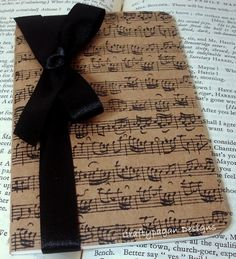 Beautiful Altered Kraft Moleskine Cahier which has been hand stamped with music notes.