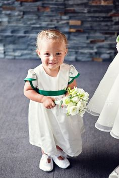 Green-trimmed flower girl dress.