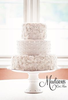 White on White....rosette and quilted - There's something to be said about an all white wedding cake. My bride Shannon was so elegant, and she wanted to incorporate the rosette pattern with the quilted pattern. I did the top and bottom tier in white buttercream rosettes, then the middle tier was covered in fondant with a quilted pattern with hand piped buttercream dots. Photography by Kevin Paul Photography.