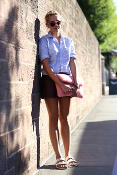 Laurel Pantin in a white top, shorts and white birkenstock sandals.