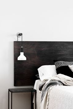Simple dark wood headboard. The Veda House Blog