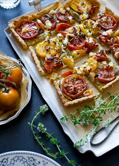 Heirloom Tomato Tart - pesto, onions, stunning heirloom tomatoes. From White on Rice Couple.