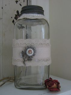 Love old jars!  LOVE old jars embellished with vintage lace and jewelery!