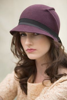The arrow cloche hat is made from wool felt which has a hand formed arrow detail on the left side, a chic city hat which will go beautifully