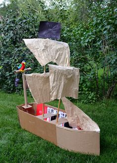 Pirate ship from boxes. Awesome! We used to make cars with cupcake tins for lights, plates for wheels, etc... Super fun weekend project!