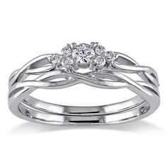 A brilliant round-cut diamond is the centerpiece of this 10k white gold bridal set. A unique weaved design forms the backdrop for the center diamond in a prong setting that is surrounded by six smaller ones. Gift box included.