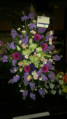 Beautiful funeral spray for the service. americasflorist.com