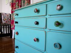 I love the bold color of this dresser as well as the mismatched knobs.