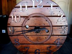 Huge clock from a reclaimed cable spool and house numbers.
