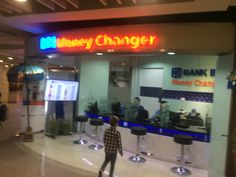 money changer in arrivals hall. Bank BRI in the arrivals hall. money changers in the airport offer considerably lower rates than on the streets of kuta/legian/seminyak/sanur/jimbaran etc.