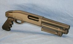 The Serbu Super-Shorty 12-gauge pump shotgun.  Barely legal...