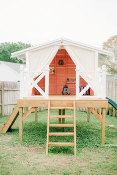 Handmade playhouse in backyard for child's first birthday party