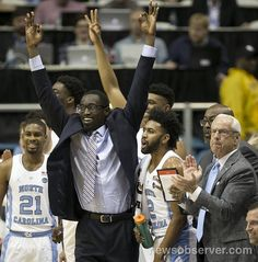 North Carolina's Theo Pinson, out with an injury, leads the cheers from the bench for teammate Kenny Williams (24) after Williams sank a three point basket in the first half against Radford on Sunday, December 4, 2016 at the Smith Center in Chapel Hill, N.C.