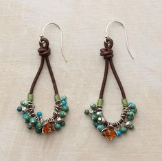 """An exuberant gathering of turquoise and Thai silver beads wired onto leather loops celebrates a carnelian-studded flower. Handcrafted exclusive; sterling silver French wires. 2-1/8""""L. 88.00 fun, and great reviews!"""