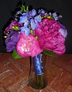Check out this beautiful hot pink peony bridesmaids wedding bouquet!