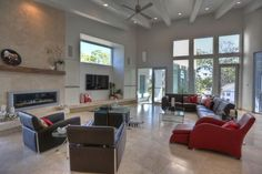 43X23 LIVING ROOM  Features 22ft ceilings, zebrawood mantle, gas rock fireplace & smooth travertine floors.
