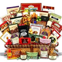 The Corporate Show Stopper™ Christmas Gift Basket #gifbasket #gift #xmass #xmas Gourmet holiday snacks include our signature Macadamia Nut Crunch Popcorn, chocolate chip cookies, dipping pretzels, raspberry honey mustard pretzel dip, gourmet roasted peanuts, a dark chocolate bar, buttered peanut crunch, metropolitan trail mix, dark chocolate raspberry sticks, mint chocolate dipped sugar cookies, chocolate covered cherries, potato sticks, 5 O'Clock Crunch, chocolate wafer rolls..