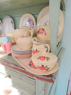 Love these pink rose dishes on the shabby hutch