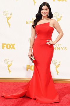 Ariel Winter wears a strapless red gown with gold accessories
