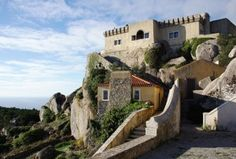 Mountain castle in Sintra, Portugal  6 Great Day Trips From Lisbon Via Four Seasons Magazine   by Warren Dunford - Jun 12, 2014  Venture from Portugal's capital city to explore stunning palaces, sample fine wines and relax on natural beaches.