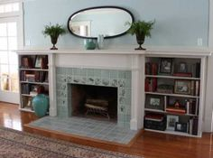 The fireplace after installation of art tile: Arts & Crafts meets Colonial Revival. Photo: T.J. Pignataro