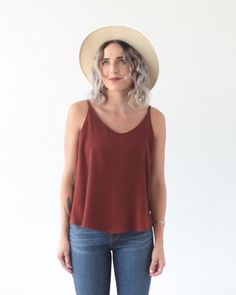 The Ogden Cami is a simple blouse that can either be worn on its own or as a layering piece under blazers and cardigans. It has a soft V neck at both center front and center back necklines, and del...