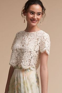 This feminine top brings a soft elegance to your look with short sleeves, jewel neckline, and scalloped floral lace. We love it paired with the Louise Tulle Skirt. Only available at BHLDN Pictured with Luanne Earrings, Calynda Heels Bridesmaid Separates, Bridal Separates, Bridesmaid Dresses, Bridesmaids, Bridal Tops, Wedding Tops, Estilo Lolita, Bhldn, Lace Tops