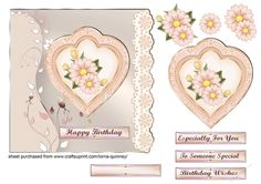 Peach Daisies by Lorna Quinney A square card front with a peach background with flowers on the left hand side and a peach lace border on the right.It has a layered heart shaped topper with peach daisies in the centre and comes with a choice of sentiment tags.