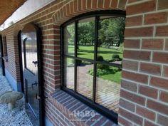 Renovatie van woonboerderij - geïsoleerde stalramen met dubbelglas