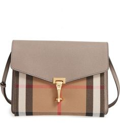 Obsessing over this Burberry crossbody bag that mixes the classic house check with well-textured leather and gold hardware for a sophisticated look.