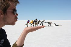 Blowing in the Wind  -    Foced Perspective   -   Pictures taken in the Salar de Uyuni, Bolivia.  The world's largest salt flats