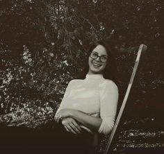 Lana Del Rey candid laughing and wearing glasses