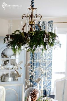 Greens in the chandelier for Christmas