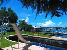 Even the pool at King's Bay Lodge is special. It's one of the few remaining spring-fed swimming pools in the state, filled with thousands of gallons of chemical-free natural spring water. Florida East Coast Beaches, Florida Pool, Florida Resorts, Clearwater Florida, Old Florida, Florida Travel, Beach Resorts, Sarasota Florida, Florida Keys